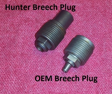 Original breech plug next to 209 breech plug