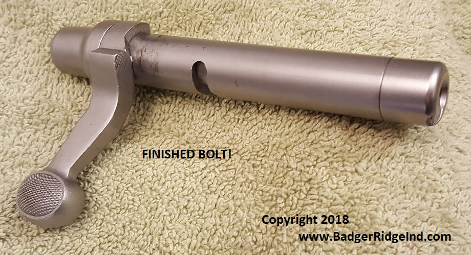 Remington 700 bolt with Badger Ridge 209 conversion